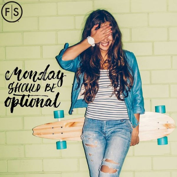 "Girl standing against brick wall with hand over her eyes and skateboard held behind her back with ""Monday should be optional"" written in black on left"