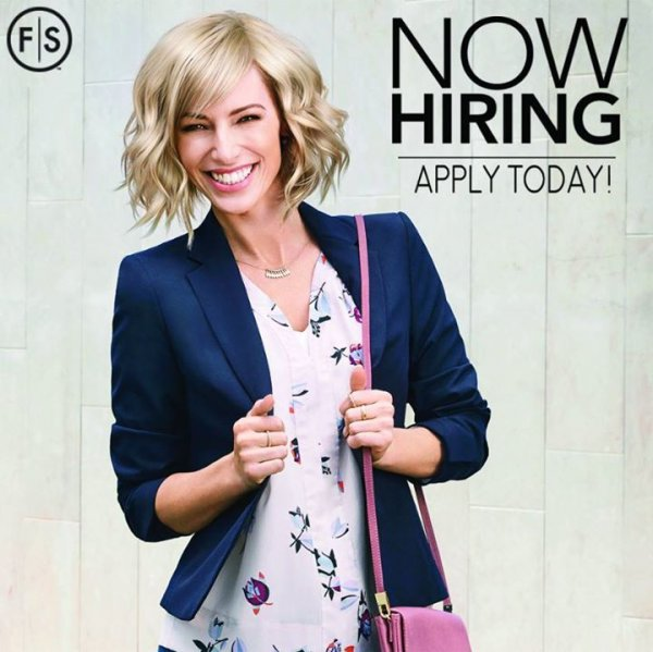 "Blonde woman in blue blazer against gray background with ""Now Hiring Apply Today!"" in upper right corner."