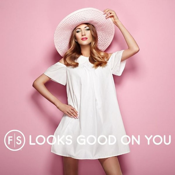"Girl in white dress with pink hat against pink backdrop with ""FS Looks Good On You"" at bottom"