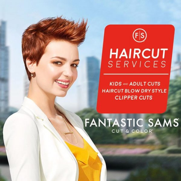 "The words ""haircut services,"" a smiling woman with short red hair"