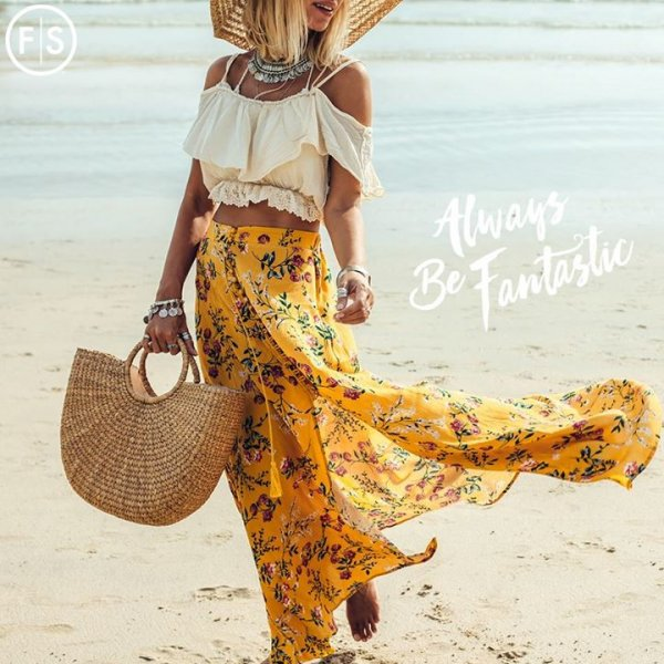 "Blonde with girl in a boho inspired outfit, and a yellow flowing skirt walking on a beach wearing a sunhat with the script ""Always be Fantastic"" on the right hand side"