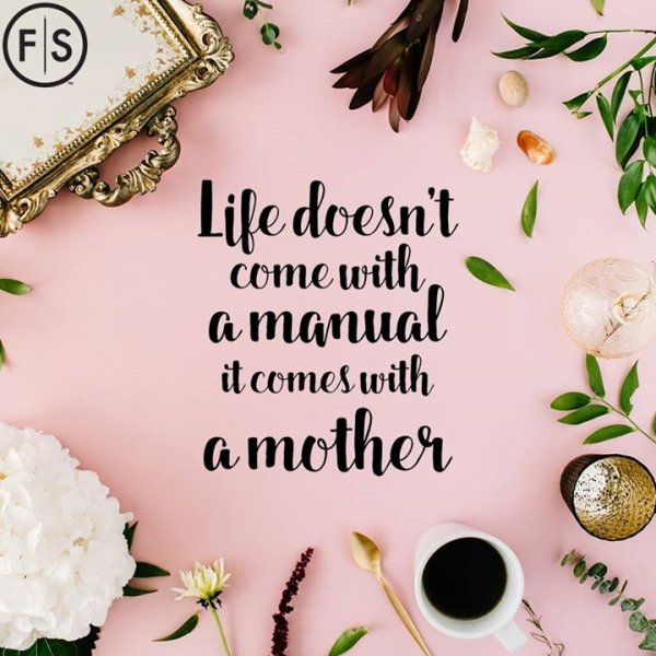"Image of a coffee cup, flowers and gold tray on pink background with ""Life Doesn't Come With a Manual, it Comes With a Mother"" written in black in middle"