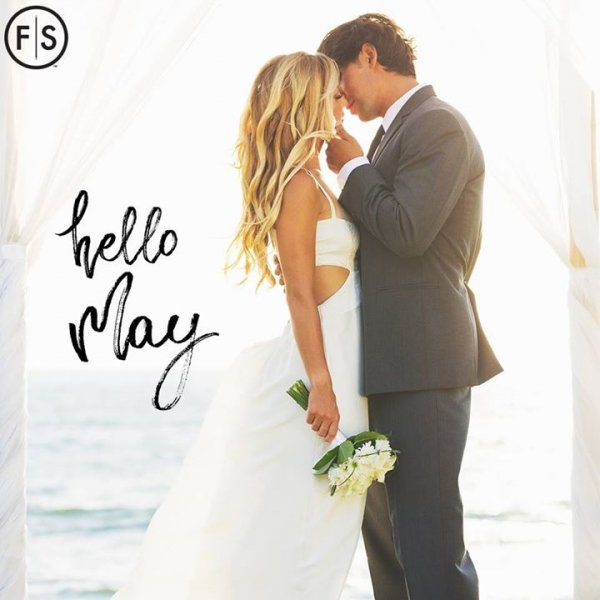 "Bride and groom on beach kissing with ""Hello May"" written to left"