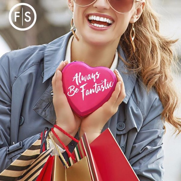 Girl with curly blonde pony tail holding heart that reads Always Be Fantastic