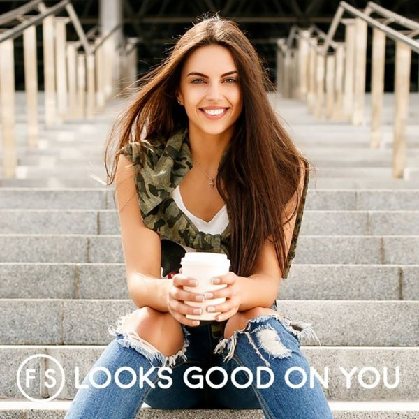"Girl with long brunette hair sitting on steps with coffee cup and ""FS Looks Good On You"" is written at the bottom"