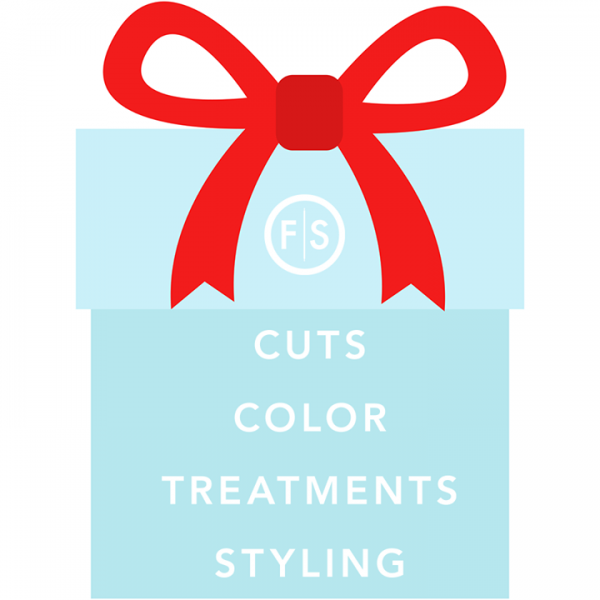 "The words ""cut, color, treatment, styling,"" inside a blue gift box."