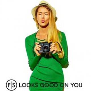"Blonde woman making kissy face while holding camera, ""FS Looks Good On You"" in black across bottom"