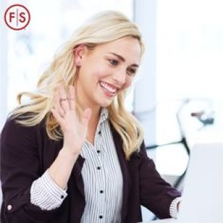 blonde woman happily zooming with someone