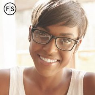 Short haired brunette woman with glasses smiling