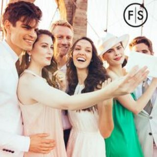 Group of young people smiling taking a selfie