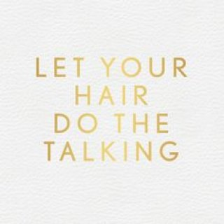 """White background with gold lettering """"Let Your Hair Do The Talking"""""""