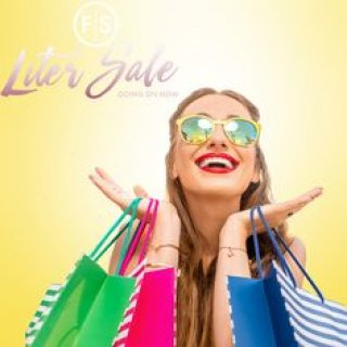 Girl wearing sunglasses smiling holding shopping bags with text in the left hand corner promoting the liter sale, going on now