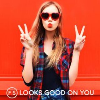 Strawberry blonde girl holding up peace signs wearing heart sunglasses with the FS logo at the bottom