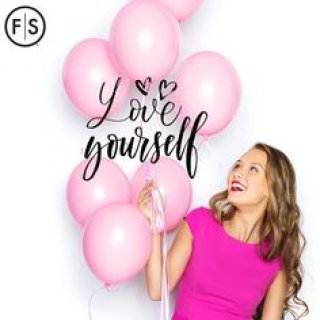 The words Love Yourself, woman holding several balloons