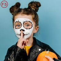 Girl with painted face in costume, holding pumpkin