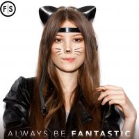 Woman in cat getup holding a strand of her hair and showing off her last minute halloween costume.