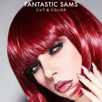 Woman with red hair looking at the camera with a Fantastic Sams logo on top.